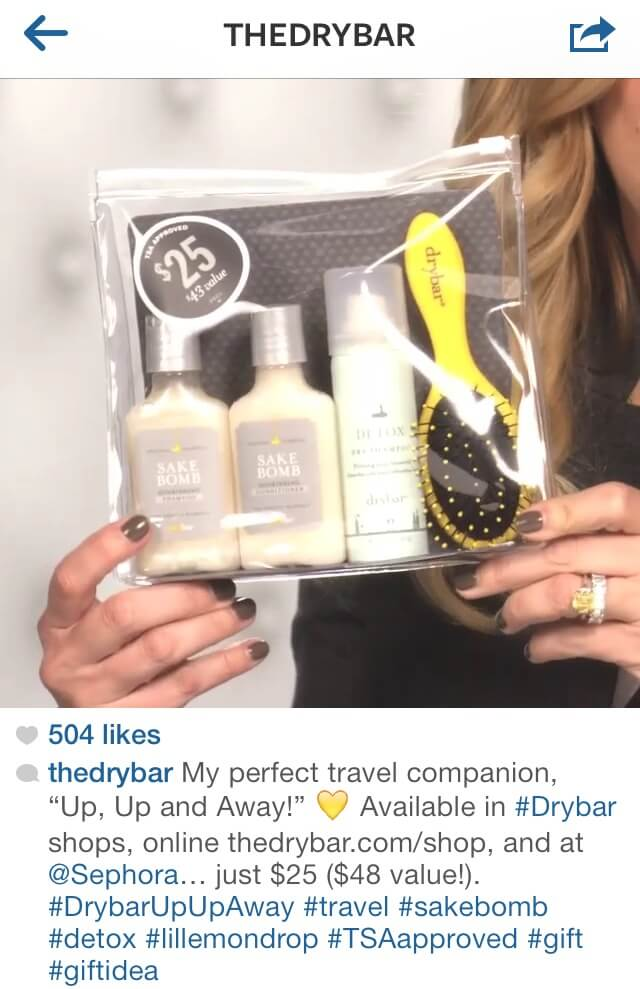 Instagram post from Drybar plus caption and hashtag featuring a travel set of hair products.
