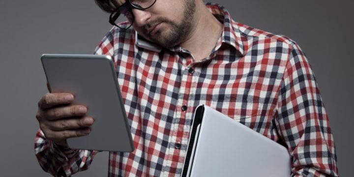 Man managing multiscreen world