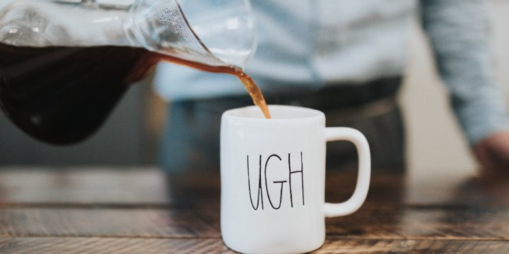 "Coffee being poured into a mug that reads ""Ugh"""