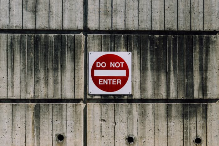 Do not enter sign on a wooden surface